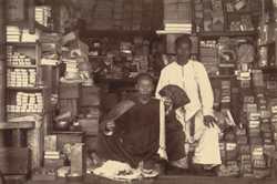 John Chinaman in his shop in King's Bazaar, Mandalay